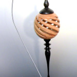 Woodturning a hollow spiral globe
